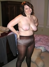 Huge knockers, black stockings, and enormous MILF peaches